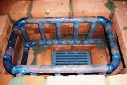 Теплообменный регистр из труб для отопительно-варочной печи